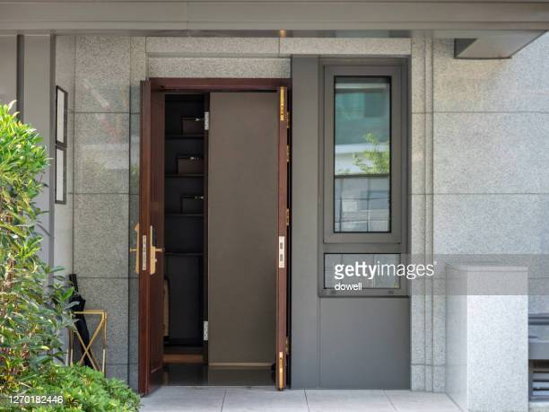 close-up of door of modern building - building entrance stock pictures, royalty-free photos & images