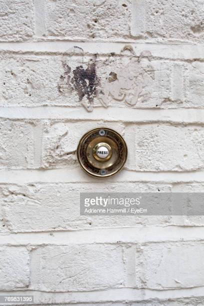 close-up of doorbell on wall - door bell stock photos and pictures
