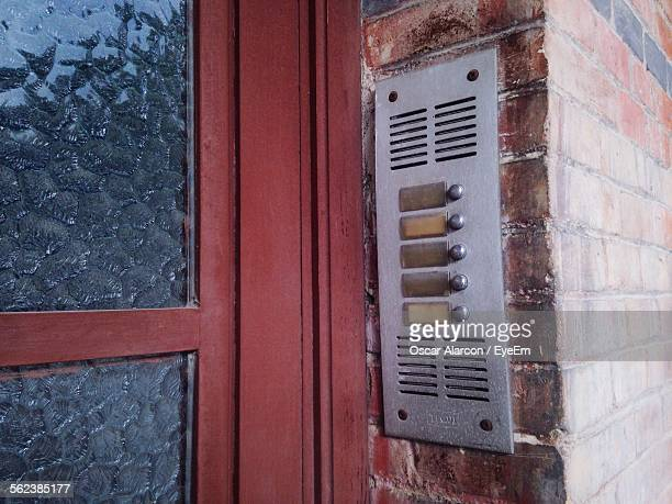 Close-Up Of Doorbells On House Wall