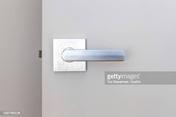 close-up of doorknob - handle stock pictures, royalty-free photos & images