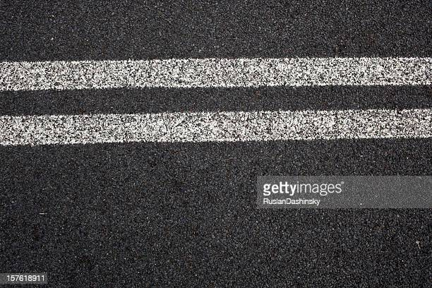 Close-up of double white lines on pavement