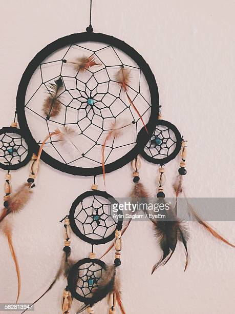 Close-Up Of Dream Catcher Hanging On Wall