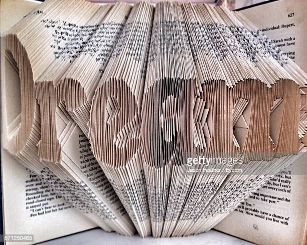 Close-Up Of Dream Text Made From Folded Papers In Book