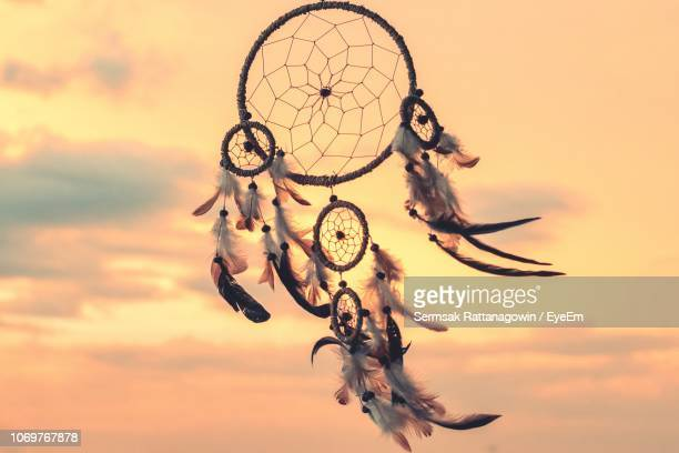 close-up of dreamcatcher against sky - dreamcatcher stock pictures, royalty-free photos & images