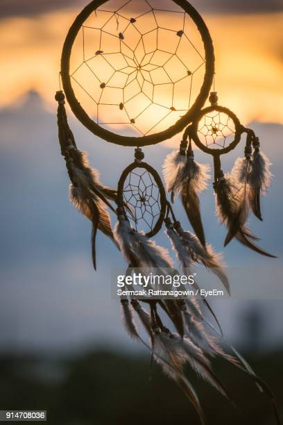 close-up of dreamcatcher during sunset - dreamcatcher stock pictures, royalty-free photos & images