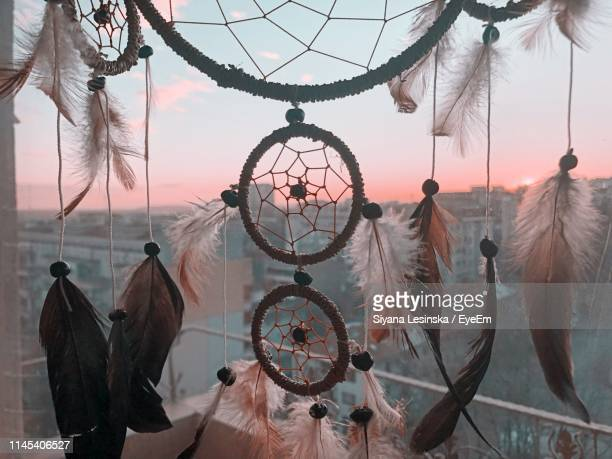 close-up of dreamcatcher hanging at home - dreamcatcher stock pictures, royalty-free photos & images