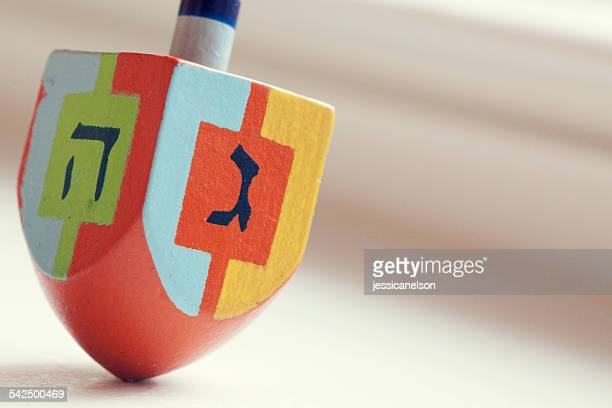 close-up of dreidel - dreidel stock photos and pictures