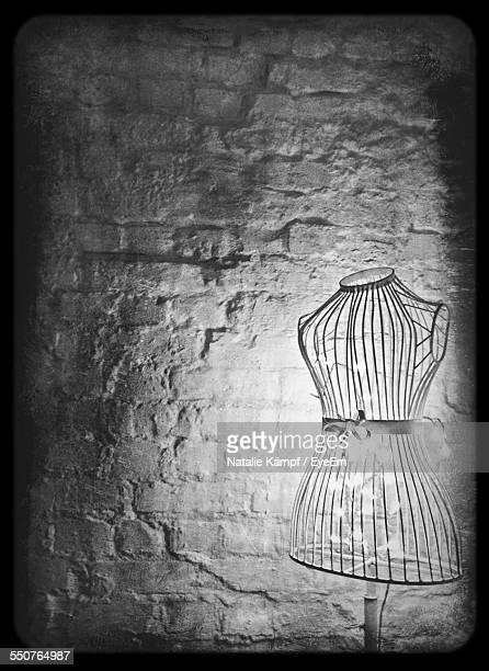 close-up of dress form against wall - dressmaker's model stock photos and pictures