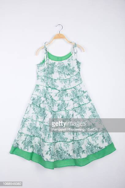 Close-Up Of Dress Hanging Against White Background