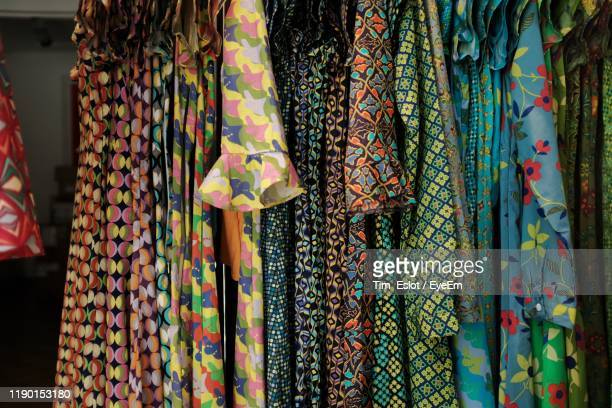 close-up of dresses hanging in store - floral pattern dress stock pictures, royalty-free photos & images