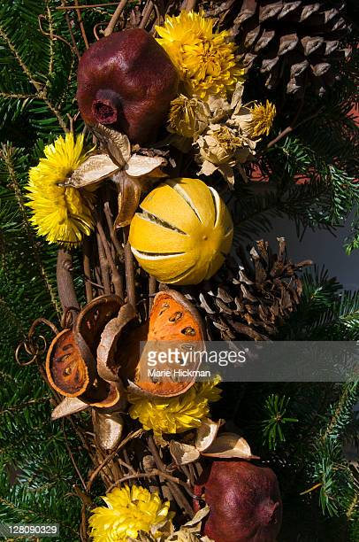 Close-up of dried cut-up citrus fruit on a wreath
