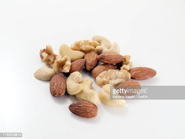 close-up of dried fruits over white background - almond stock pictures, royalty-free photos & images