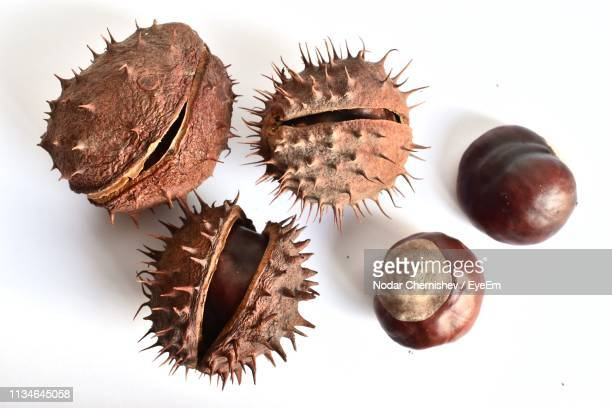 Close-Up Of Dried Fruits Over White Background