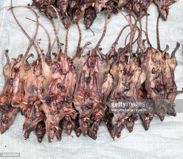 Close-Up Of Dried Mice Hanging At Market