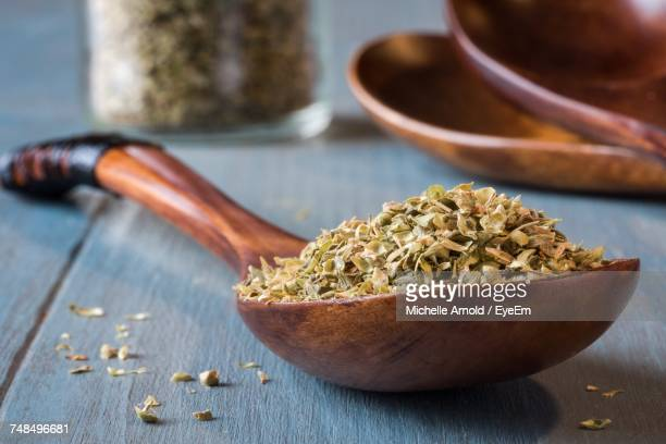 Close-Up Of Dried Oregano In Wooden Spoon On Table
