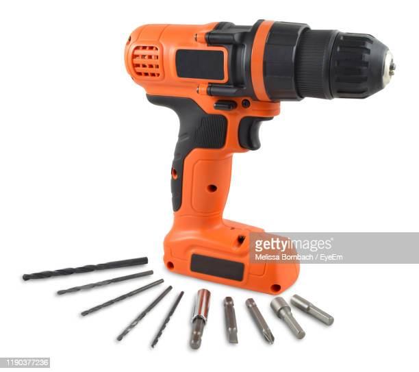 close-up of drill against white background - drill stock pictures, royalty-free photos & images