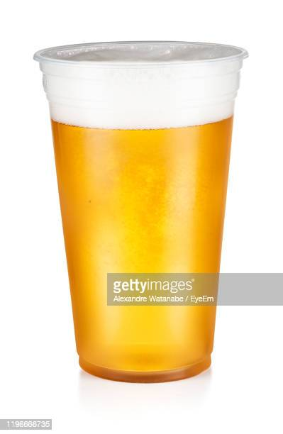 close-up of drink against white background - disposable cup stock pictures, royalty-free photos & images