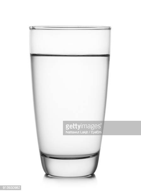 close-up of drink against white background - drinking glass stock pictures, royalty-free photos & images
