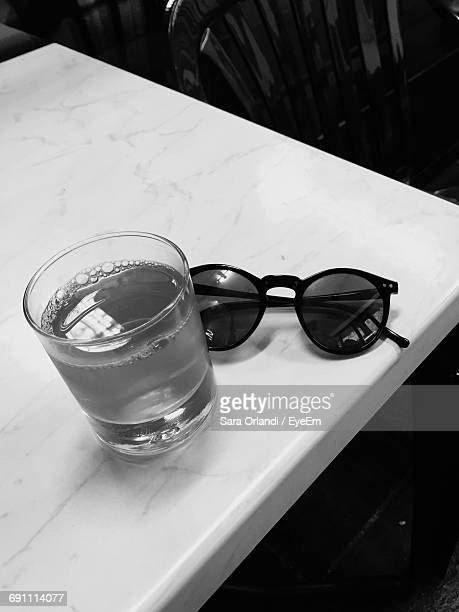 Close-Up Of Drink And Sunglasses