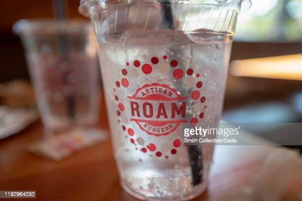 Close-up of drink cup with logo for Roam Artisan Burgers restaurant, Lafayette, California, November 25, 2019.