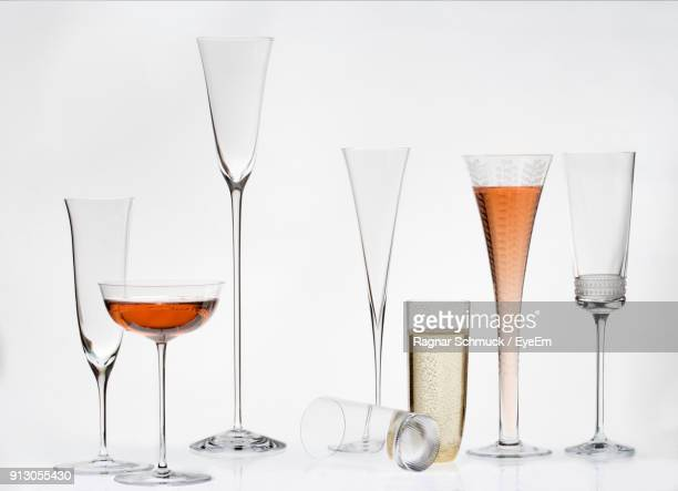 Close-Up Of Drink Glasses On White Background