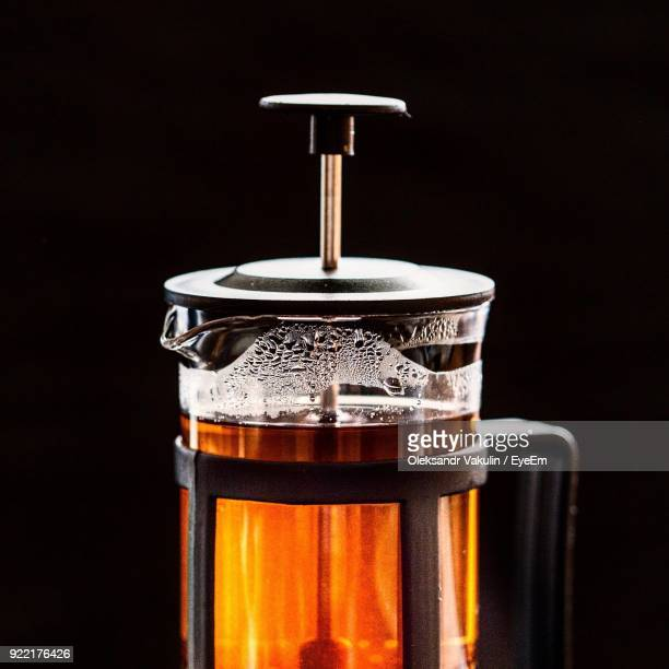 close-up of drink in container against black background - oleksandr vakulin stock pictures, royalty-free photos & images