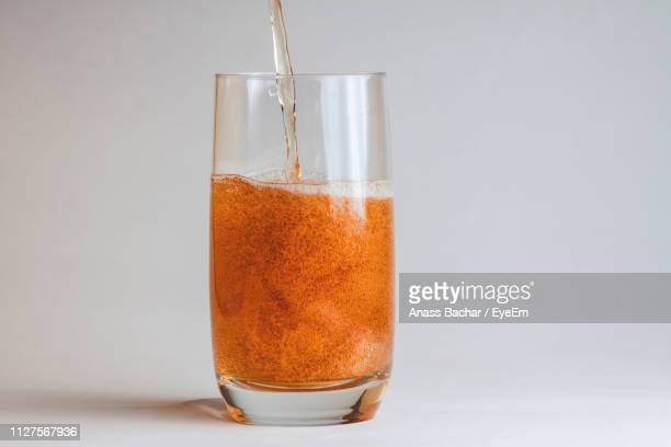Close-Up Of Drink In Glass Against White Background