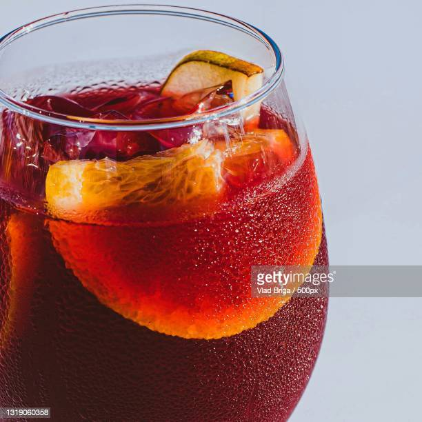 close-up of drink in glass against white background - refreshment stock pictures, royalty-free photos & images