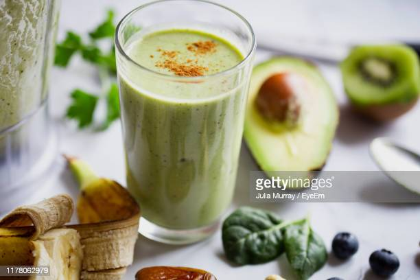 close-up of drink in glass on table - smoothie stock pictures, royalty-free photos & images
