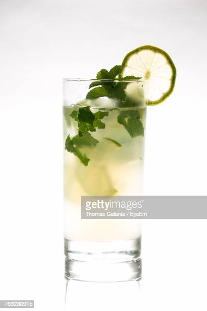 close-up of drink in glass on white background - mojito stock photos and pictures