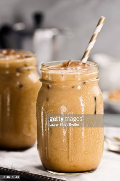 close-up of drink in jar on table - iced coffee stock pictures, royalty-free photos & images