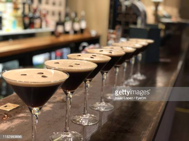 close-up of drink in martini glasses on table in restaurant - martini glass stock pictures, royalty-free photos & images