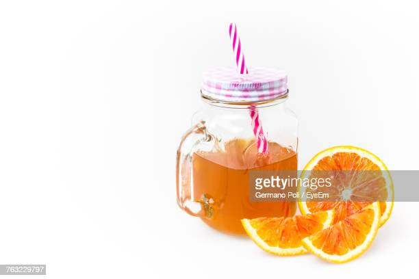 Close-Up Of Drink In Mason Jar Against White Background