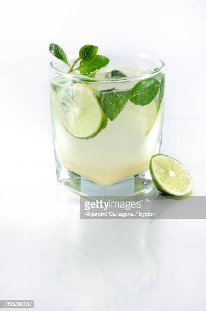 close-up of drink on table against white background - mojito stock photos and pictures