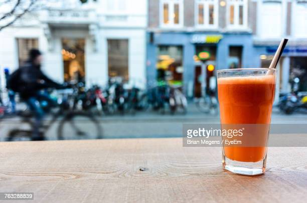 Close-Up Of Drink On Table By Street