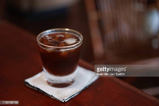close-up of drink on table - liu he stock pictures, royalty-free photos & images