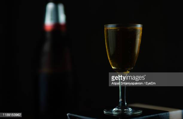close-up of drink on table - liqueur stock pictures, royalty-free photos & images