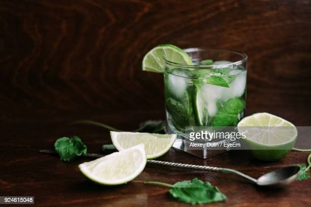 close-up of drink on table - mojito stock photos and pictures