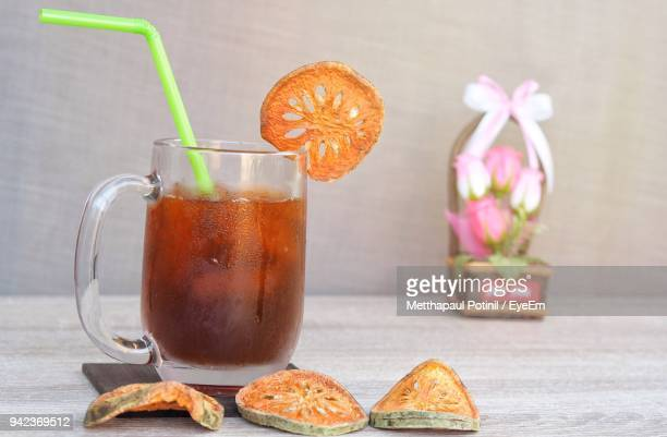 close-up of drink on table - metthapaul stock photos and pictures