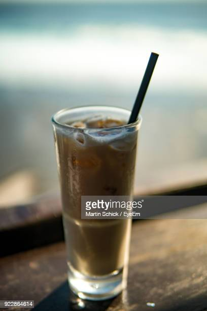 Close-Up Of Drink On Window Sill