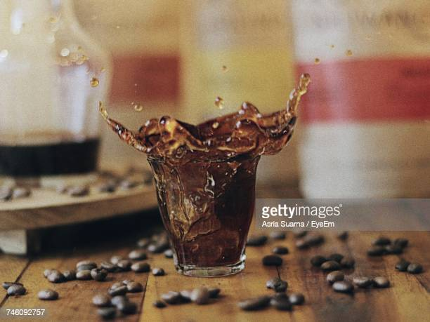 Close-Up Of Drink Splashing On Table