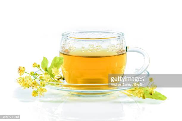 close-up of drink with flowers against white background - herbal tea stock pictures, royalty-free photos & images