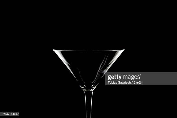 Close-Up Of Drinking Glass Against Black Background