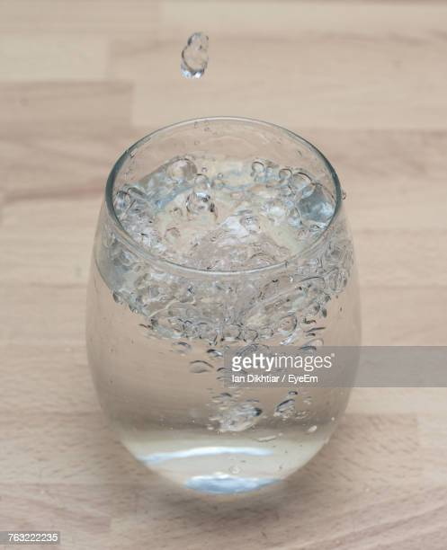 Close-Up Of Drinking Glass On Wooden Table