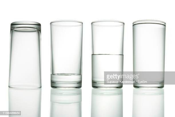 close-up of drinking glasses against white background - 逆さ ストックフォトと画像