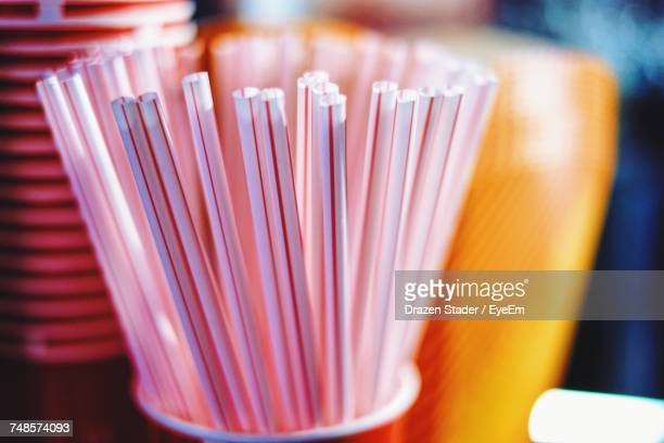 close-up of drinking straws in container - drinking straw stock pictures, royalty-free photos & images