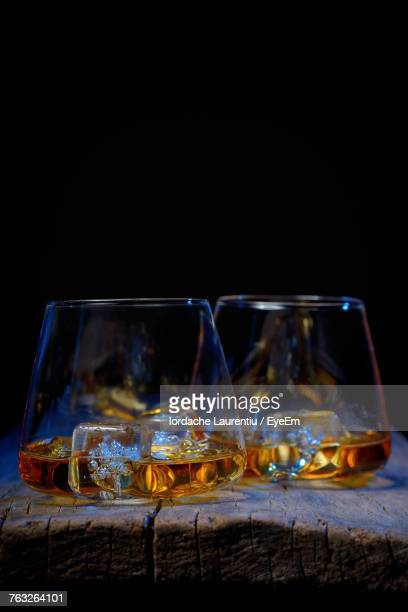 close-up of drinks against black background - liqueur stock pictures, royalty-free photos & images