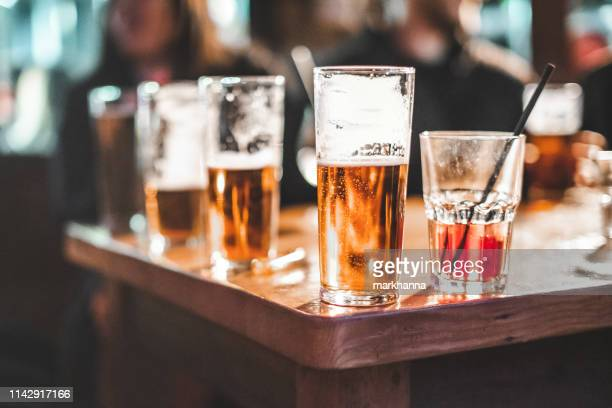 close-up of drinks on a table - alcoholismo fotografías e imágenes de stock