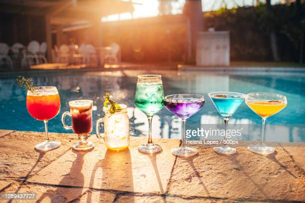 close-up of drinks on table at poolside,belo horizonte,minas gerais,brazil - belo horizonte stock pictures, royalty-free photos & images