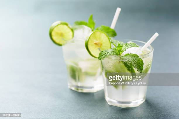 close-up of drinks on table - mojito stock photos and pictures